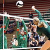 John P. Cleary | The Herald Bulletin<br /> Pendleton Heights's Avery Ross, right, gets one of her 10 kills by Anderson defenders Lauryn Williams and Eliana Munoz.