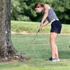 John P. Cleary | The Herald Bulletin<br /> Lapel's Lauren Lutz punches out from the base of this tree on #14 during their match with Daleville Wednesday at Edgewood Golf Club.