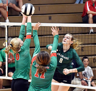 John P. Cleary | The Herald Bulletin Anderson defenders Hannah Haywood and Eliana Munoz try to block Averi Lanman's kill shot during their match with Pendleton Heights.
