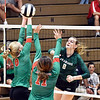 John P. Cleary | The Herald Bulletin<br /> Anderson defenders Hannah Haywood and Eliana Munoz try to block Averi Lanman's kill shot during their match with Pendleton Heights.