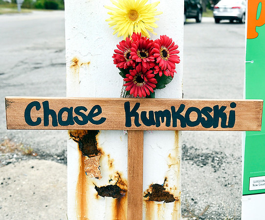 John P. Cleary | The Herald Bulletin<br /> This is one of two memorial crosses for Chase Kumkoski at the intersection of 25th & Raible Avenue where he was killed in a motorcycle accident   three weeks ago.