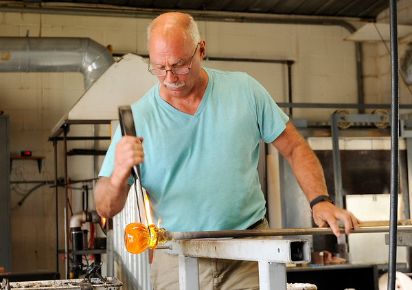 Don Knight | The Herald Bulletin<br /> Kerry Zimmerman from Corydon, Ind. creates a glass vase at the House of Glass during the Elwood Glass Festival on Friday.