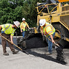 Don Knight | The Herald Bulletin<br /> A crew from Milestone paves the east bound lane of Indiana 32 through Edgewood on Friday. The work is part of a $2.6 million project to repave the highway from Layton Road on the west side of the city to Scatterfield Road on the east.