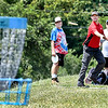 John P. Cleary | The Herald Bulletin<br /> Randy Drennen, left, and Lee Whitman, right, watch as Karl Ahern lets his shot fly as the trio play disc golf Thursday afternoon at the Sanders Memorial Disc Golf Course at Edgewater Park.