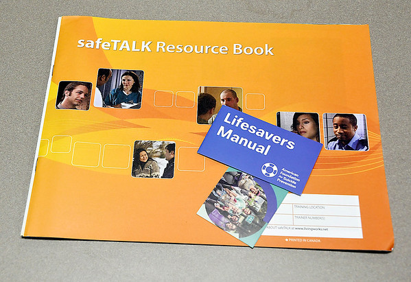 John P. Cleary | The Herald Bulletin<br /> Suicide prevention training for ACS teachers used this resource book for their training.