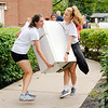 Don Knight | The Herald Bulletin<br /> Claire Miller, left, and Ruth Knies carry a refrigerator into Martin Hall as the tennis team helps new students move in to Anderson University on Thursday.
