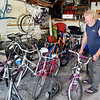 John P. Cleary | The Herald Bulletin<br /> Scott Bates in his garage bicycle workshop. Bates started Bicycles4Kids of Madison County in 2006 refurbishing more then 3,500 bikes.