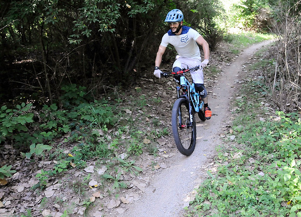 Don Knight | The Herald Bulletin<br /> A cyclist hits the trail at the Rangeline Nature Preserve on Wednesday. The park has trails for beginner, intermediate and advanced mountain bikers.