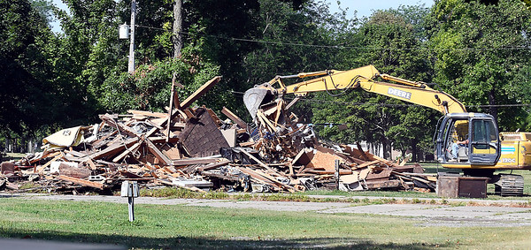 John P. Cleary | The Herald Bulletin<br /> Workers from Fredericks, Inc. make short order of the old Church of God campground administration building on the Anderson University campus Thursday as they demolished the building and were clearing the site.