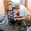 Don Knight | The Herald Bulletin<br /> Pete Monagham from Dublin Ohio assembles a cart for his son Gavin's dorm room in Dunn Hall on move-in day at Anderson University on Thursday.