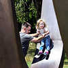 John P. Cleary | The Herald Bulletin<br /> Dwayne Morris uses the Changing Forms sculpture as a slide for his daughter Adilynn, 2, as they play at Shadyside Park Friday afternoon. Morris, of Lafayette, grew up in Anderson and said he remembers playing on the art pieces when he was a child.