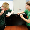 Don Knight | The Herald Bulletin<br /> From left, Zach Sarvis and Robert Seal open a broken television to see what is inside during the Create and Destroy event at the Alexandria-Monroe Public Library on Wednesday.