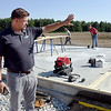 John P. Cleary | The Herald Bulletin<br /> Builder Chad Lukens looks over the site as workers prepare the foundation to start framing this new home being built in southwestern Madison County.