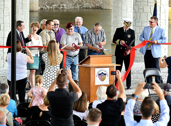 John P. Cleary | The Herald Bulletin<br /> Local and national officials have a laugh as these military veterans cut the dedication ribbon a little to soon during the ceremony for the new Dwight D. Eisenhower Veteran's Memorial Bridge Thursday afternoon.