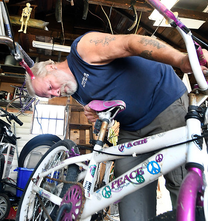 John P. Cleary | The Herald Bulletin<br /> Scott Bates checks out this bike in his garage workshop. who started Bicycles4Kids of Madison County. Bates started Bicycles4Kids of Madison County in 2006.