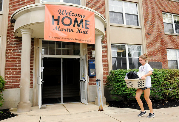 Don Knight | The Herald Bulletin<br /> Anderson University's tennis team helps new students move into Martin Hall on Thursday. The new semester starts Monday.