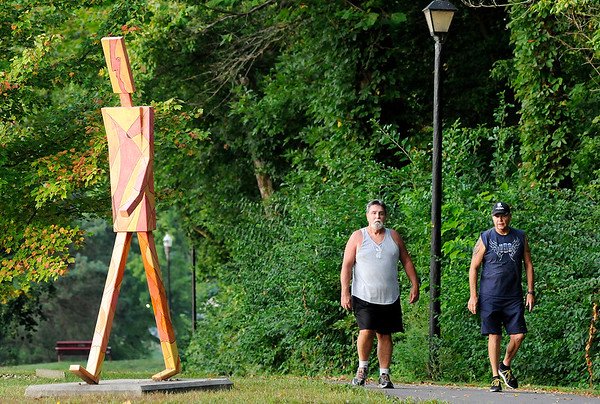 Don Knight | The Herald Bulletin From left, Don Musik and Ray Porter talk as they walk together at Shadyside Park on Thursday morning. Exercise and social engagement are two of four ways researchers have found you can reduce your risk for Alzheimer's.