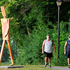 Don Knight | The Herald Bulletin<br /> From left, Don Musik and Ray Porter talk as they walk together at Shadyside Park on Thursday morning. Exercise and social engagement are two of four ways researchers have found you can reduce your risk for Alzheimer's.