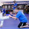 "Don Knight | The Herald Bulletin<br /> Lenora Carey, 4, participates in a Kick-A-Thon with help from Brian ""Stryker"" Nevins during Freedom Martial Arts annual Freedom Fest on Saturday. Proceeds from Saturday's event help pay for scholarships that allow children without the means to pay study martial arts."
