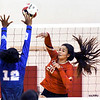 John P. Cleary | The Herald Bulletin<br /> Liberty Christian's Elena Tufts, right, hits the ball past APA's Tyra Gillispie.