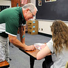 Don Knight | The Herald Bulletin<br /> Pendleton teacher Dave Cloud works with a student in his classroom.