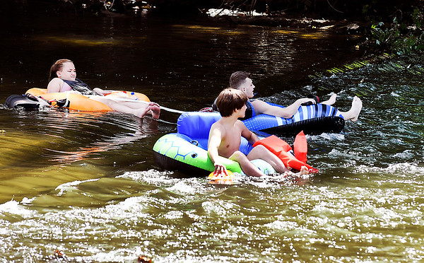 John P. Cleary | The Herald Bulletin<br /> These folks were enjoying a warm summer day floating down White River through Anderson Wednesday afternoon. Here they were heading for the Broadway bridge, working their way toward Madison Avenue.