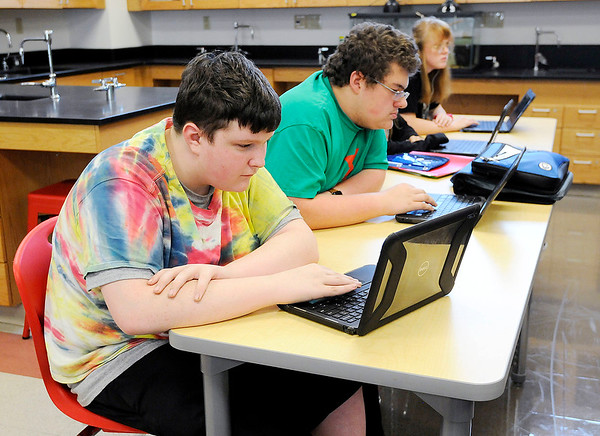 Don Knight | The Herald Bulletin<br /> From left, Martin O'Flynn and Jacob Heffelmire work on their assignments in Michael Knost's biology class at Anderson High School on Friday.