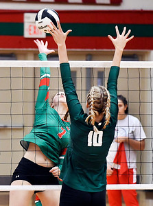 John P. Cleary | The Herald Bulletin Anderson's Taylor Weber stretches to get the ball over Pendleton Heights defender Gracie King.