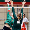 John P. Cleary | The Herald Bulletin<br /> Anderson's Taylor Weber stretches to get the ball over Pendleton Heights defender Gracie King.