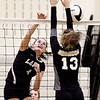 John P. Cleary | The Herald Bulletin<br /> Lapel's Zoe Freer spikes the ball past Daleville's Kadence Linn.