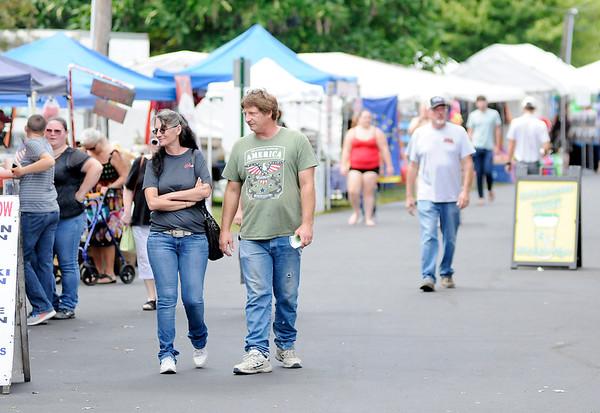 Don Knight | The Herald Bulletin<br /> The path through Callaway park is lined with vendors for the 48th Elwood Glass Festival. The festival opened on Friday and runs through Sunday.