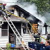 John P. Cleary | The Herald Bulletin<br /> Firefighters from multiple agencies battled a house fire in the 2900 block of County Road 150 South Monday afternoon. Chesterfield-Union Twp. Fire Department responded to the call along with units from Salem Twp., Adams Twp., Richland Twp., Yorktown, and Pendleton fire departments. The fire caused extensive damage to the structure.