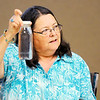 Don Knight | The Herald Bulletin<br /> Advanced Indiana Master Naturalist Mary Powell carries six glass bottles of water in a cooler in her car as an alternative to buying water in single use bottles.
