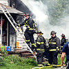 John P. Cleary | The Herald Bulletin<br /> Firefighters from multiple agencies battled a house fire in the 2900 block of County Road 150 South Monday afternoon. The fire caused extensive damage to the structure.