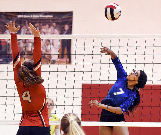 John P. Cleary | The Herald Bulletin<br /> Liberty Christian's Mady Rees, #4, jumps to block the shot of APA's Olivia Jones, #7.