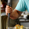 Don Knight | The Herald Bulletin<br /> Kerry Zimmerman from Corydon, Ind. forms the neck of a glass vase at the House of Glass during the Elwood Glass Festival on Friday.