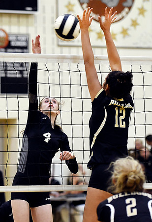 John P. Cleary | The Herald Bulletin<br /> Daleville's Ava Papai tips the ball over the hands of Lapel's Makynlee Taylor.