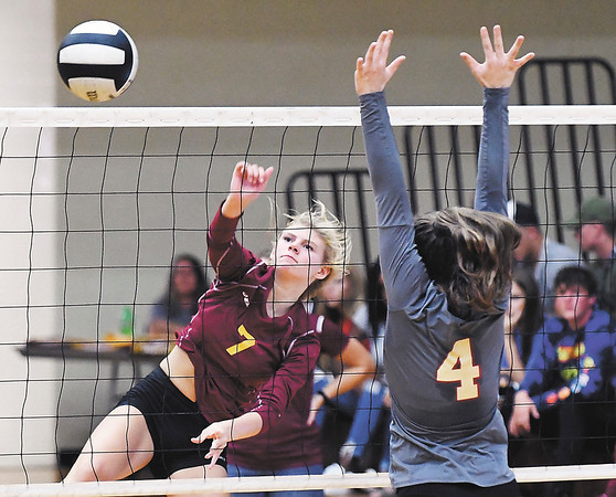 John P. Cleary | The Herald Bulletin<br /> Alexandria's Lauren Dungan spikes the ball over the net as Liberty Christian's Mady Rees tries to defend.