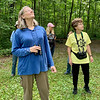 Donna Browne, left, and Ann Wolfe, both from Muncie, look for birds among the treetops surrounding a clearing at Mounds State Park. Browne and Wolfe took part in the Robert Cooper Audubon Society's monthly bird walk at the park.