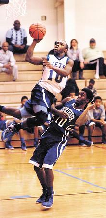 APA's Tyler Smith-Johnson leaps high to the basket against Shortridge's Brandon Johnston-Adkisson.
