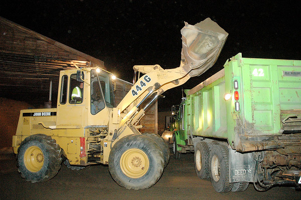 A front loader dumps salt in the bed of a tandem truck early Wednesday morning. The Madison County Highway Department put 13 dump trucks and seven smaller trucks on the roadways.