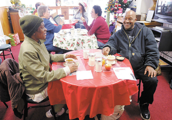 From left, Denise Green and L Jones-El enjoy a cup of coffee at The Help Center in Anderson. The Help Center is a faith based program reaching out to area homeless located at 1103 Main Street next to the CATS station.
