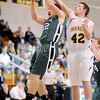 Pendleton Heights' Peyton McCardwell blocks out Shenandoah's Terick Warner and grabs a defensive rebound as the Raiders hosted the Arabians on Friday.