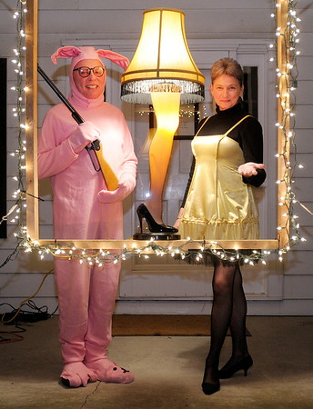 """Doctor Phillip Shirley and his lady friend Gloria show their love for the classic holiday movie """"A Christmas Story"""" with a leg lamp and matching costumes."""