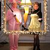 "Doctor Phillip Shirley and his lady friend Gloria show their love for the classic holiday movie ""A Christmas Story"" with a leg lamp and matching costumes."