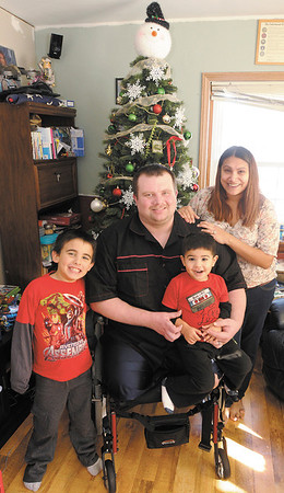 Tim Senkowski is home to spend time with his family, from left, sons Dusty and Embry and wife Erica during the holidays before returning to Walter Reed to continue his therapy.