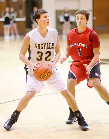 Madison-Grant's  Aaron Patton looks to pass as he is guarded by Blackford's Harley Bales on Wednesday.