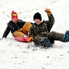 Hannah Schuyler, 9, and Shalee Key, 13, race each other down the hill at Shadyside Park Friday as they enjoyed an afternoon of sledding.