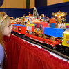 Cassi Hayes, 4, gets a close-up look at the circus train that is part of Larry Davenport's Train Village display during Winterfest activities at the Paramount Theatre Friday.