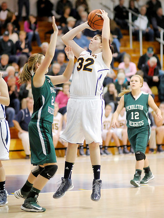Shenandoah's Rachel Krathwohl shoots as she is guarded by Pendleton Heights' Taylor Siefken as the Raiders hosted the Arabians on Friday.